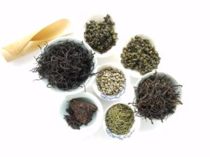tea-cup-green-chinese-herb-soil